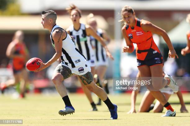 Cecilia Mcintosh of the Magpies runs with the ball during the AFLW Rd 4 match between Collingwood and GWS at Morwekk Recreation Reserve on February...