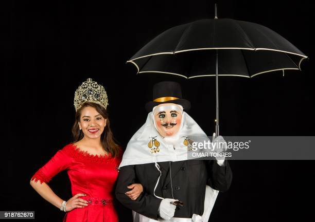 Cecilia Mendez and Marco Flores pose in their Catrines costumes for the carnival in Tlaxcala Mexico on February 13 2018 The satirical costumes and...