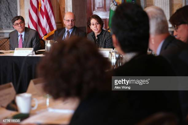 Cecilia Munoz assistant to the President Obama and director of the Domestic Policy Council speaks as US Secretary of the Treasury Jacob Lew and...