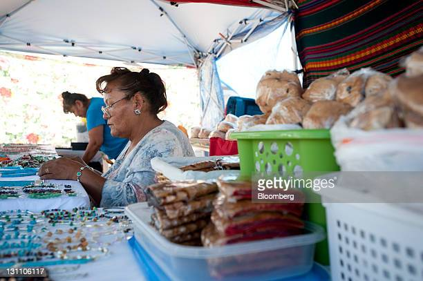 Cecilia Nieto from Santo Domingo New Mexico sets up her display of Navajo jewelry to sell along with homemade bread and pie at the Ch'ihootso Indian...