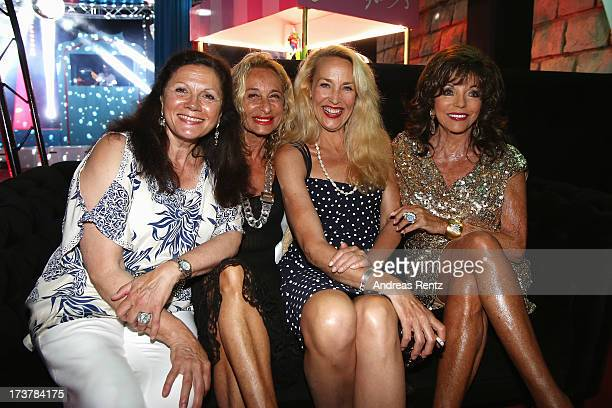 Cecilia Norick guest Jerry Hall and Joan Collins attend the Denise Rich annual St Tropez party on July 17 2013 in SaintTropez France