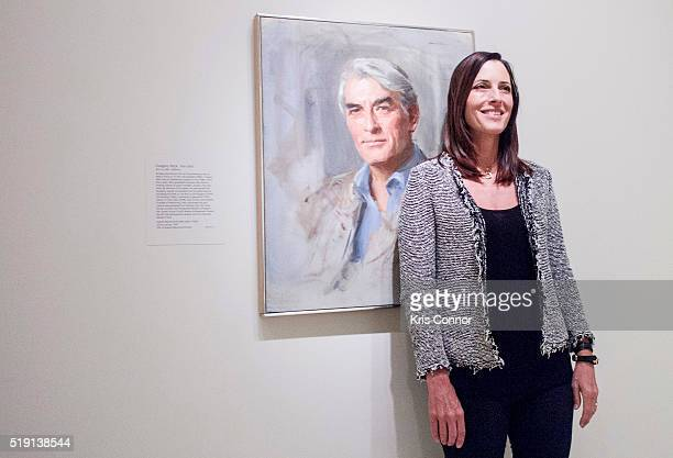 Cecilia Peck poses with a portrait of her father actor Gregory Peck by Everett Raymond Kinstler at The Smithsonian National Portrait Gallery on April...