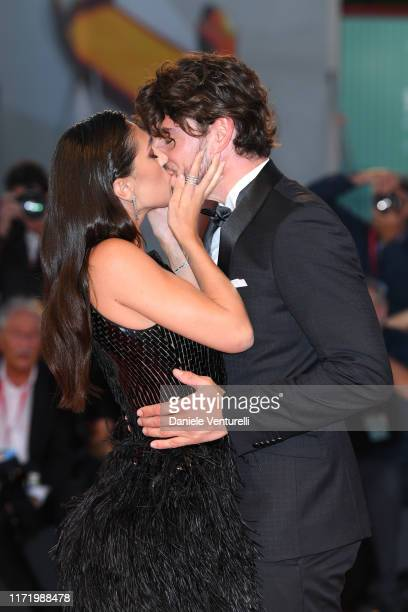 Cecilia Rodríguez and Ignazio Moser kiss walking the red carpet ahead of the Om Det Oandliga screening during the 76th Venice Film Festival at Sala...