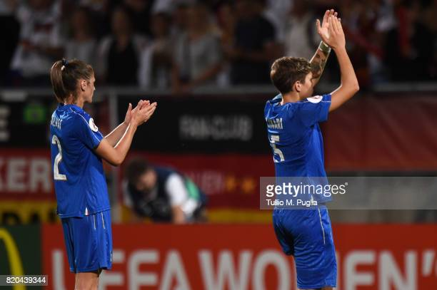Cecilia Salvai and Elena Linari of Italy greet supporters after losing the UEFA Women's Euro 2017 Group B match between Germany and Italy at Koning...
