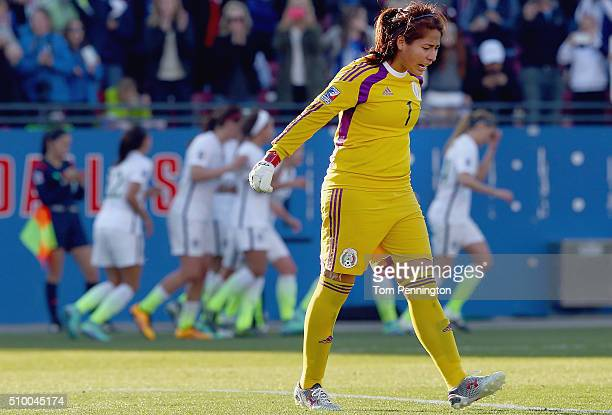 Cecilia Santiago of Mexico reacts after giving up a goat against Carli Lloyd of USA in the second half during the United States v Mexico Group A 2016...