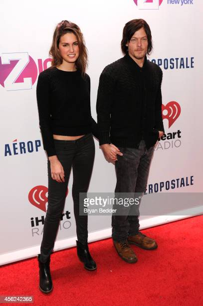 Cecilia Singley and Norman Reedus attend Z100's Jingle Ball 2013 presented by Aeropostale at Madison Square Garden on December 13 2013 in New York...
