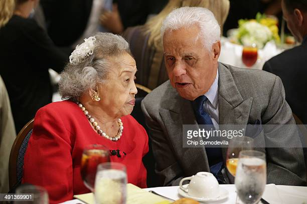 Cecilia Suyat Marshall talks with former Virginia Governor Douglas Wilder during the NAACP Legal Defense Fund's luncheon to commemorate the Supreme...