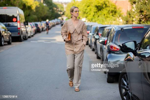 Cecilia Thorsmark is seen wearing beige striped button shirt outside By Malene Birger during Copenhagen Fashion Week Spring/Summer 2021 on August 12,...