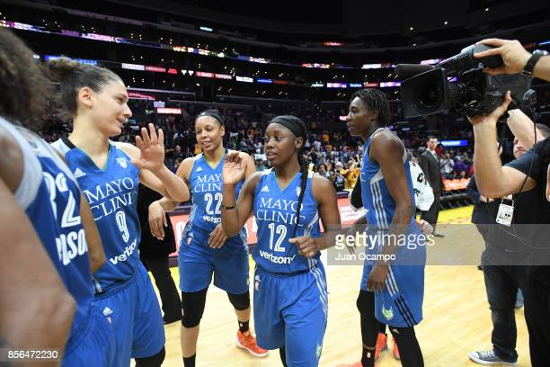 Cecilia Zandalasini and Alexis Jones of the Minnesota Lynx with teammates celebrate a win against the Los Angeles Sparks in Game Four of the 2017...