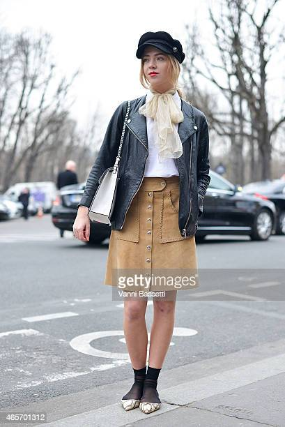 Cecilie Lindegaard poses wearing an H and M jacket Gap shirt vintage skirt and Zara bag on Day 7 of Paris Fashion Week Womenswear FW15 on March 9...