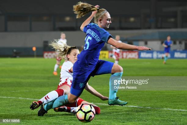 Cecilie Sandvej of Denmark competes for the ball with Cheyenne van den Goorberghof Holland during the Women's Algarve Cup Tournament match between...