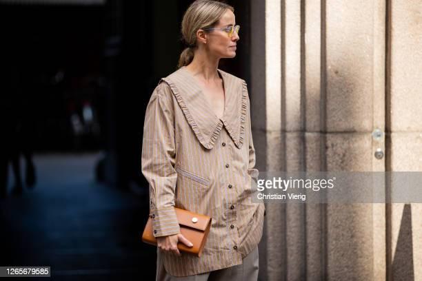 Cecilie Thorsmark is seen wearing beige striped button shirt grey pants outside Skall Studio during Copenhagen Fashion Week Spring/Summer 2021 on...