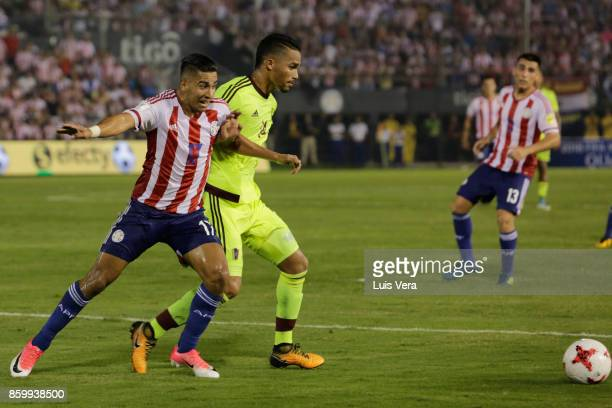 Cecilio Domiguez of Paraguay fights for the ball with Yangel Herrera of Venezuela during a match between Paraguay and Venezuela as part of FIFA 2018...