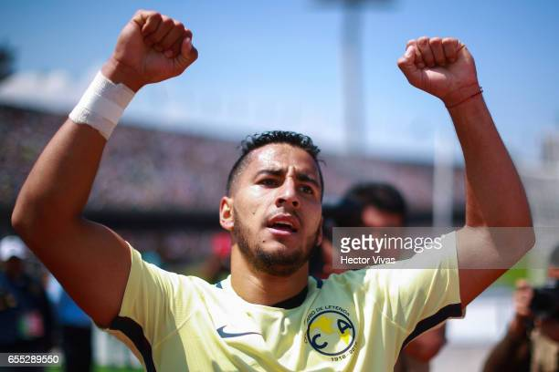 Cecilio Dominguez of America celebrates after scoring the third goal of his team during the 11th round match between Pumas UNAM and America as part...