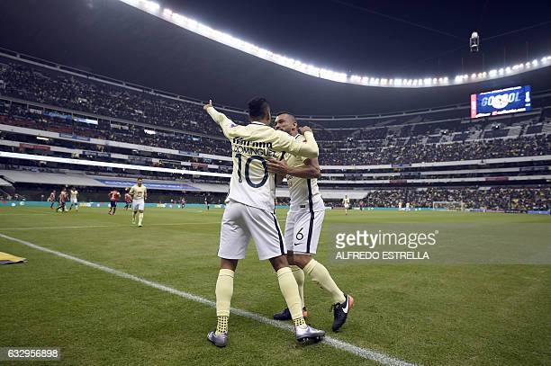 Cecilio Dominguez of America celebrates his goal against Veracruz with his teammate during their match of the Mexican Soccer Apertura 2017 tournament...