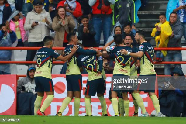 Cecilio Dominguez of America celebrates with teammates after scoring the first goal of his team during the 2nd round match between Pachuca and...
