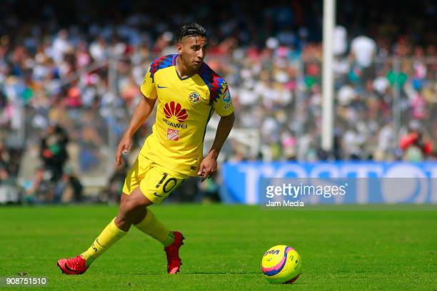 Cecilio Dominguez of America drives the ball during the third round match between Pumas UNAM and America as part of Torneo Clausura 2018 Liga MX at...