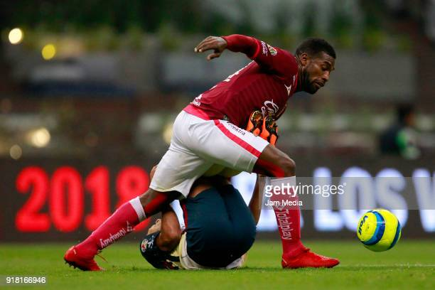 Cecilio Dominguez of America fights for the ball with Gabriel Achilier of Morelia during the 7th round match between America and Monarcas as part of...