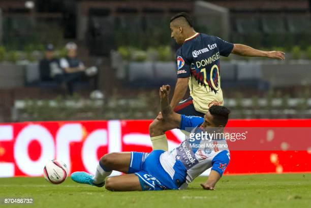 Cecilio Dominguez of America fights for the ball with Hugo Rodriguez of Puebla during the 16th round match between America and Puebla as part of the...