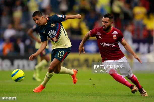 Cecilio Dominguez of America fights for the ball with Mario Osuna of Morelia during the 7th round match between America and Monarcas as part of the...