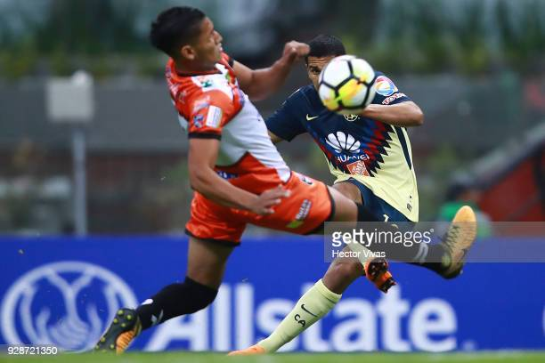 Cecilio Dominguez of America kicks the ball to score the third goal of his team during the match between America and Tauro FC as part of the CONCACAF...