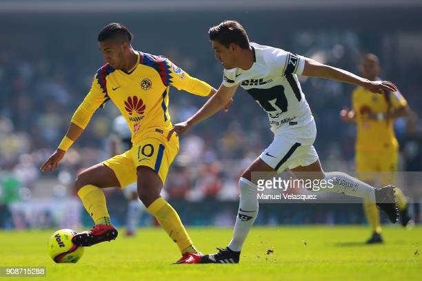 Cecilio Dominguez of America struggles for the ball with Josecarlos Van Rankin of Pumas during the 3rd round match between Pumas UNAM and America as...
