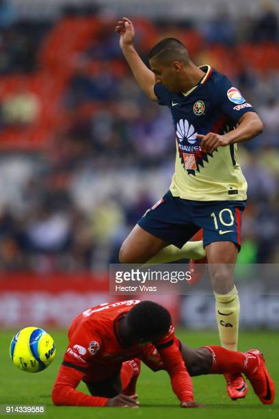 Cecilio Dominguez of America struggles for the ball with Luis Advincula of Lobos BUAP during the 5th round match between America and Lobos BUAP as...