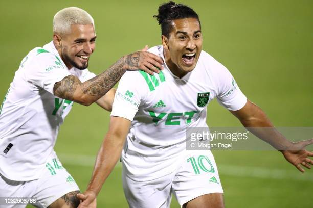 Cecilio Dominguez of Austin FC reacts to his goal with Diego Fagundez of Austin FC against the Colorado Rapids during the second half at Dick's...