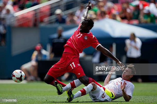 Cecilio Waterman of Panama gets tangled up with Nikolas Ledgerwood of Canada while battling for the ball during the second half of a CONCACAF Gold...