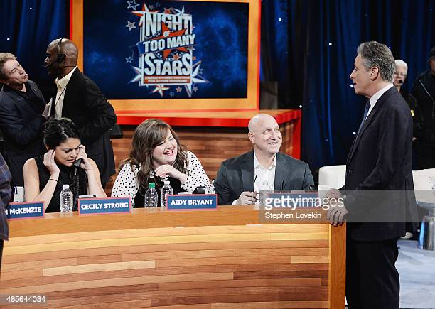 Cecily Strong Aidy Bryant Tom Colicchio and Jon Stewart attend The Night Of Too Many Start Live Telethon on March 8 2015 in New York City