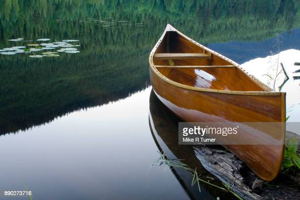 cedar canoe - canoe stock pictures, royalty-free photos & images