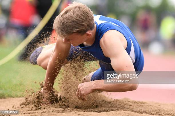 Cedar Ridge's Josh Jenkins falls forward in the triple jump pit at the Colorado State Track and Field Championships on Friday May 18 2018