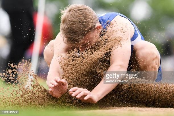 Cedar Ridge's Josh Jenkins gets a face full of dirt in the triple jump pit at the Colorado State Track and Field Championships on Friday May 18 2018