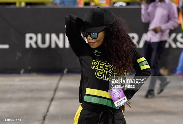 Cedella Marley poses with Jamaica's Women football team 'Reggae Girlz' after the friendly football match Jamaica vs Panama at the National Stadium in...