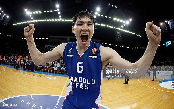 Cedi Osman #6 of Anadolu Efes Istanbul celebrates victory during the 20142015 Turkish Airlines Euroleague Basketball Regular Season Date 5 game...