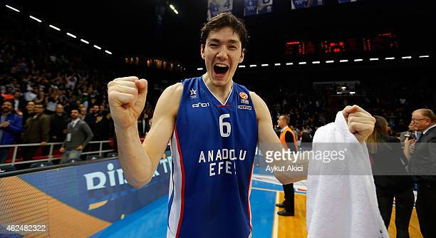 Cedi Osman #6 of Anadolu Efes Istanbul celebrates victory during the Euroleague Basketball Top 16 Date 5 game between Anadolu Efes Istanbul v...