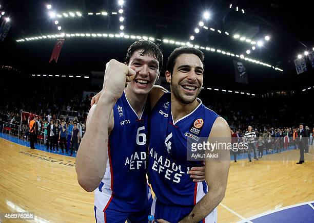 Cedi Osman #6 of Anadolu Efes Istanbul celebrates victory with Dogus Balbay #4 of Anadolu Efes Istanbul during the 20142015 Turkish Airlines...