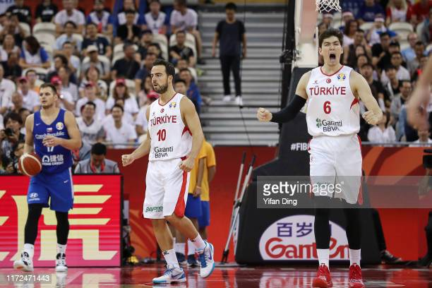 Cedi Osman and Melih Mahmutoglu of Turkey reacts after making a three point shot during the 1st round match between Turkey and Czech Republicublic of...
