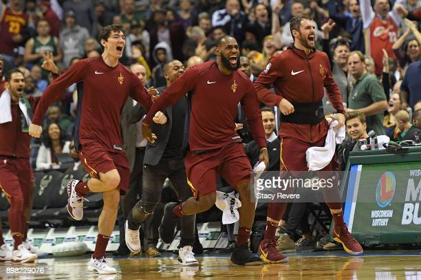 Cedi Osman LeBron James and Kevin Love of the Cleveland Cavaliers celebrate a late score during a game against the Milwaukee Bucks at the Bradley...