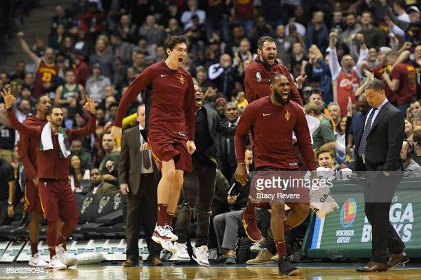 Cedi Osman LeBron James and Kevin Love of the Cleveland Cavaliers celebrate a late score during a game against the Milwaukee Bucks Bradley Center on...
