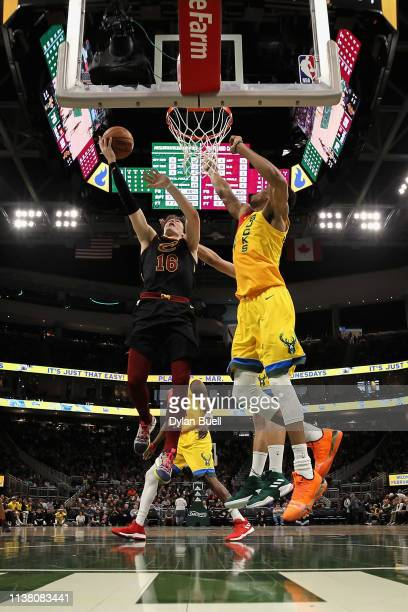 Cedi Osman of the Cleveland Cavaliers attempts a layup while being guarded by Giannis Antetokounmpo of the Milwaukee Bucks in the third quarter at...