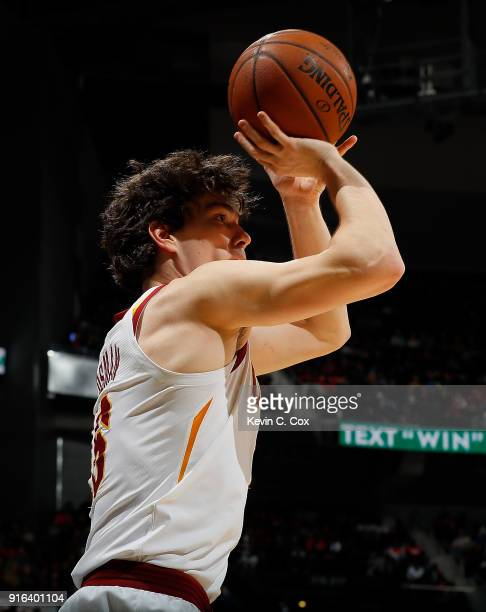 Cedi Osman of the Cleveland Cavaliers attempts a shot against the Atlanta Hawks at Philips Arena on February 9 2018 in Atlanta Georgia NOTE TO USER...