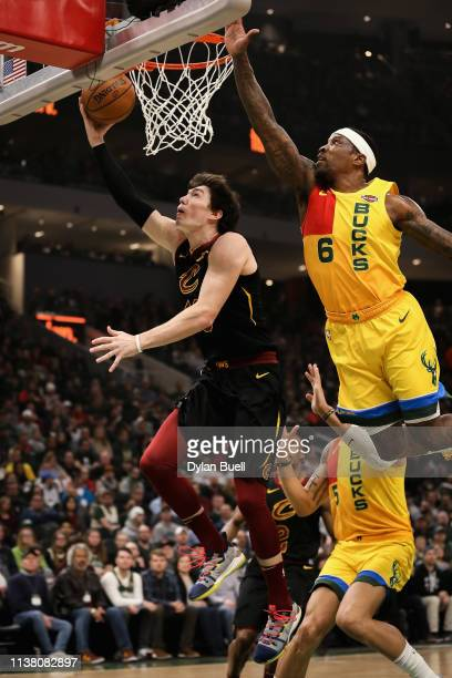 Cedi Osman of the Cleveland Cavaliers attempts a shot while being guarded by Eric Bledsoe of the Milwaukee Bucks in the first quarter at the Fiserv...