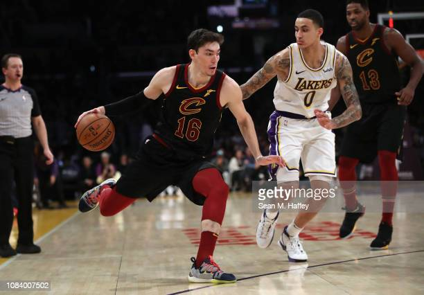 Cedi Osman of the Cleveland Cavaliers dribbles past Kyle Kuzma of the Los Angeles Lakers during the second half of a game at Staples Center on...