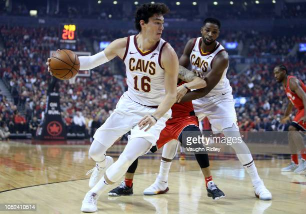 Cedi Osman of the Cleveland Cavaliers dribbles the ball as Fred VanVleet of the Toronto Raptors defends during the first half of the NBA season...