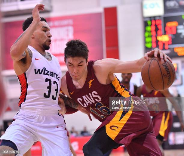 Cedi Osman of the Cleveland Cavaliers drives against Chris Chiozza of the Washington Wizards during the 2018 NBA Summer League at the Cox Pavilion on...