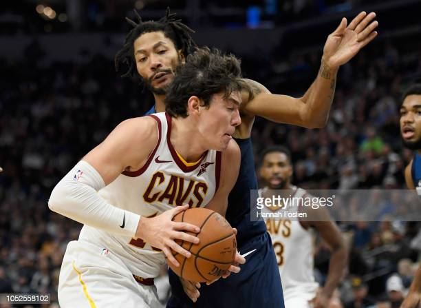 Cedi Osman of the Cleveland Cavaliers drives to the basket against Derrick Rose of the Minnesota Timberwolves during the second quarter of the game...
