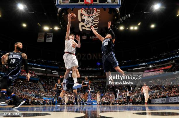 Cedi Osman of the Cleveland Cavaliers dunks against Aaron Gordon of the Orlando Magic on January 6 2018 at Amway Center in Orlando Florida NOTE TO...