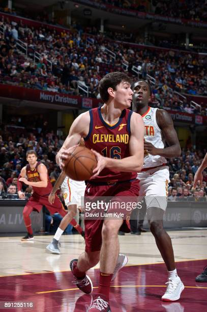 Cedi Osman of the Cleveland Cavaliers handles the ball against the Atlanta Hawks on December 12 2017 at Quicken Loans Arena in Cleveland Ohio NOTE TO...