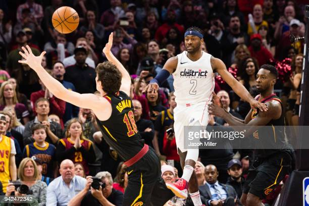 Cedi Osman of the Cleveland Cavaliers intercepts a pass from John Wall of the Washington Wizards during the finals second of the second half at...